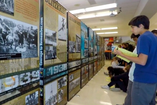 "Students inspect the ""Courage to Remember"" Holocaust exhibit"