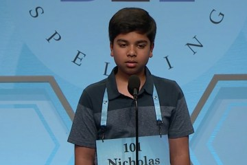 student on stage during spelling bee