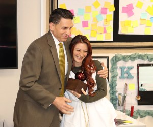 county superintendent hugs a teacher of the year