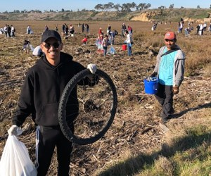 students cleaning up refuse