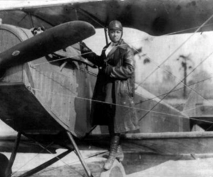 historic photo of female pilot on plane