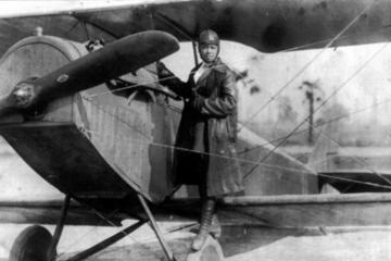 historic photo of female pilot on plane