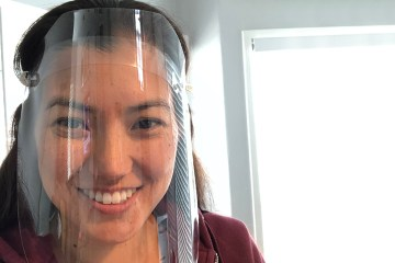 woman demonstrates face shield