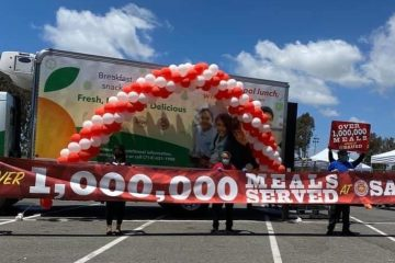 "balloons and a sign that reads, ""1,000,000 meals served"""