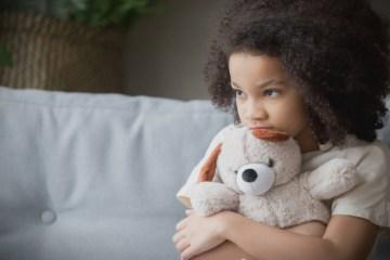 Girl with stuffed animal