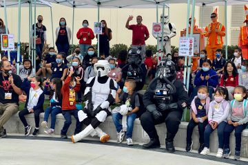 Star Wars characters with students and staff