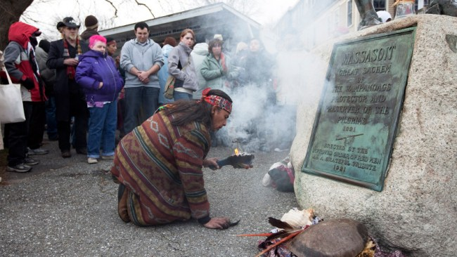 "Native American rekindles a small fire. The smoke symbolizing a ritual for healing and a connection with the ""creator."" 