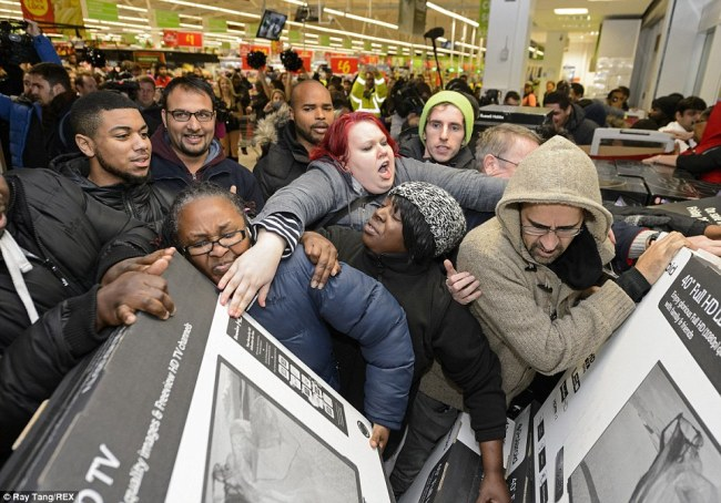 Customers push each other out of the way as the crowd surges towards widescreen televisions at the Asda store in Wembley | Source: TheDailyMail/RayTang/REX