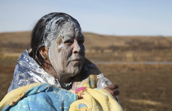 Native American woman recovers from being pepper sprayed by police at Standing Rock, near Cannon Ball, N.D | Source: NPR, John L. Mone/AP