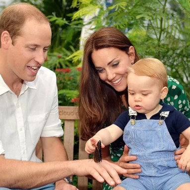 LONDON, ENGLAND - JULY 02: (EDITORIAL USE ONLY) Catherine, Duchess of Cambridge holds Prince George as he points to a butterfly on Prince William, Duke of Cambridge's hand as they visit the Sensational Butterflies exhibition at the Natural History Museum on July 2, 2014 in London, England. The family released the photo ahead of the first birthday of Prince George on July 22. (Photo by John Stillwell - WPA Pool/Getty Images)