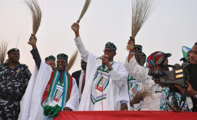 General Buhari holding a broom at a campign rally e1472927364268 - APC restates Buhari's commitment to Nigeria's economy resuscitation
