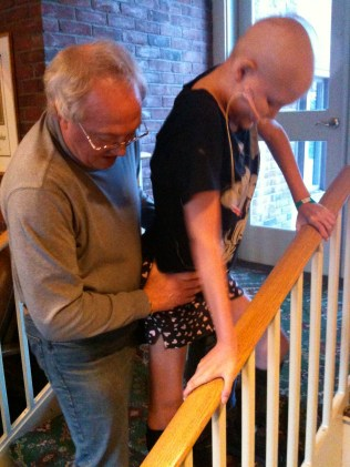 Alan assisting Jesi on the stairs at TRAPP, 12/2010