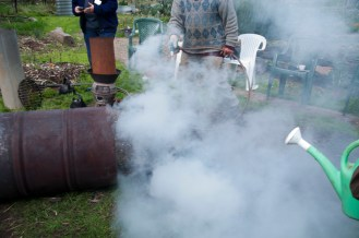 tip ot contents, hose it quickly to cool biochar and prevent further burning