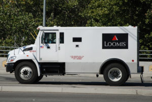 Armoured trucks transport the cash of cannabis-related businesses to the local tax office. Photo: Navymailman
