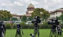 **EDS PLEASE NOTE: RPT WITH DAY CORRECTION** New Delhi: Lensmen at the Supreme Court, in New Delhi on Tuesday, July 17, 2018. The apex court on Tuesday asked Parliament to consider enacting a new law to effectively deal with incidents of mob lynching. (PTI Photo/Manvender Vashist)  (PTI7_17_2018_000034B)