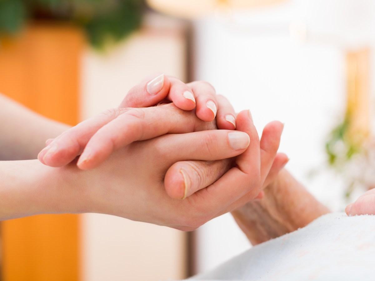 dementia-caregiver-hand