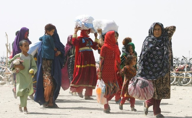 Afghans Flock To Iranian Border, But Few Can Cross