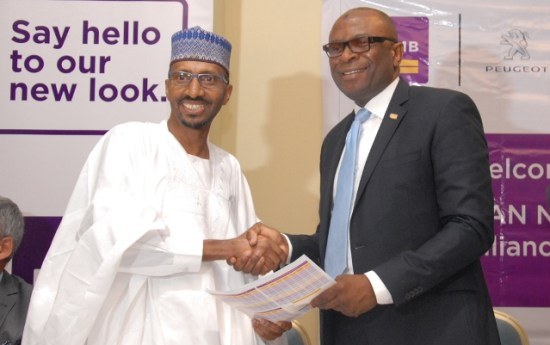 L-R: Mr. Ibrahim Boyi, Managing Director/Chief Executive of Peugeot Automobile Nigeria (PAN) Limited, and Mr. Mustapha Lukman, Regional Director, Abuja & North of First City Monument Bank (FCMB) Limited, during the launch of the FCMB/PAN Auto Loan Alliance Scheme on Thursday in Abuja