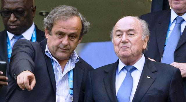 FIFA hands Blatter, Platini eight years ban
