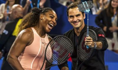 Federer wins in historic clash with Serena