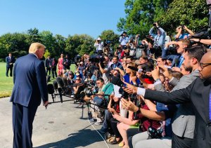 Trump holds a mini presser before going on vacation