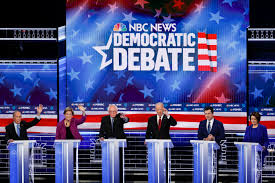 Candidates pile on front-runner Sanders at Democratic debate