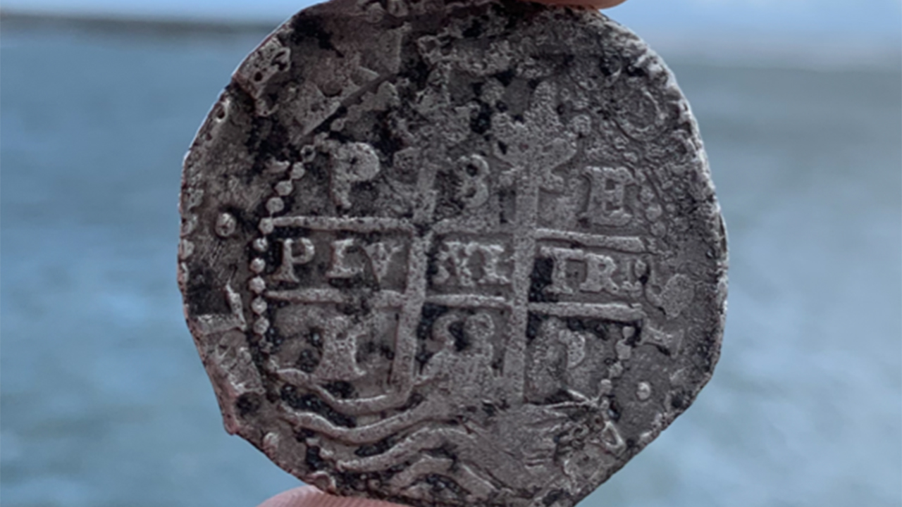 Florida Man finds 300 year old silver coins on beach