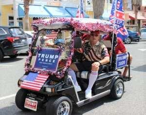 MAGAts clash with Democrats at golf cart parade for Trump