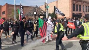 Police pepper spray voters marching to to the polls in North Carolina