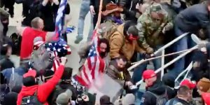 Death Is the Only Remedy': Capitol Rioter Charged for Beating D.C. Cop With American Flagpole