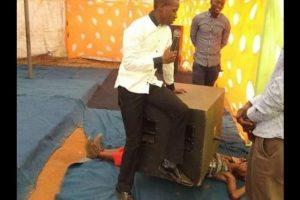 Pastor sitting on the speaker.