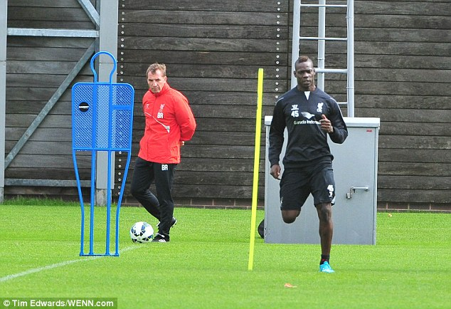 1409312920443_wps_66_Liverpool_players_are_see