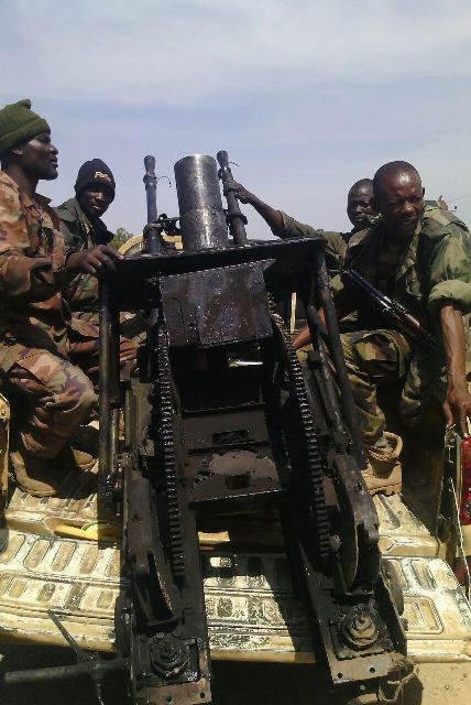 Troops with one of the captured weapons
