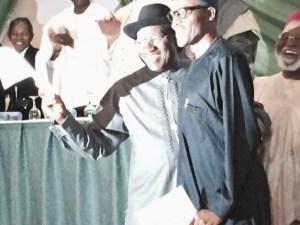 Jonathan, Buhari hug