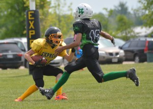 A TNT Bantam player runs out of options deep in the Express zone during Sunday's game against the Toronto Jets.
