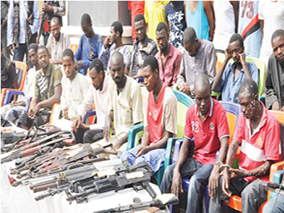 Police parade 30 kidnappers, robbery suspects in Kogi