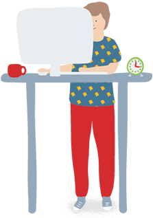 Man standing at desk using computer