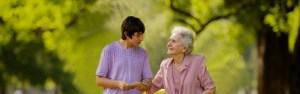 Helping Grandma walk down path
