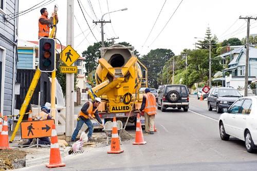 Council contractors installing traffic lights.