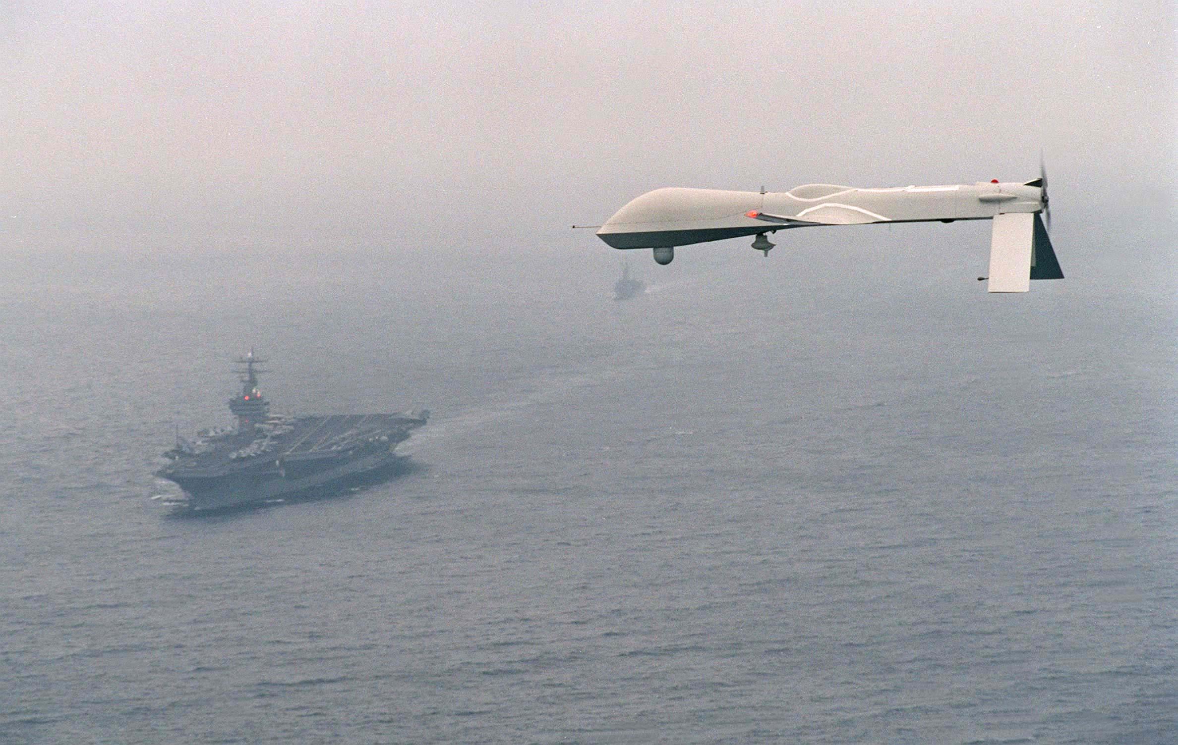 Predator UAV flies above the aircraft carrier USS Carl Vinson (CVN 70) on  Dec. 5, 1995.