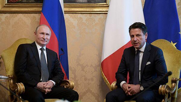 Путин обсудил с премьером Италии ситуацию в Ливии