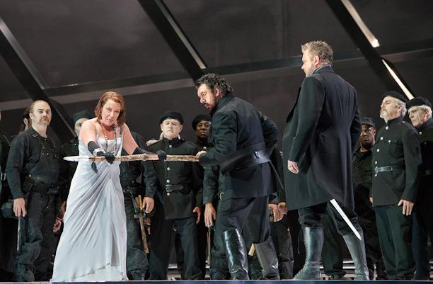 Götterdammerung, Act II: Nina Stemme (Brünnhilde), Andrea Silvestrelli (Hagen) and Ian Storey (Siegfried) with members of the San Francisco Opera chorus. Photo Cory Weaver.