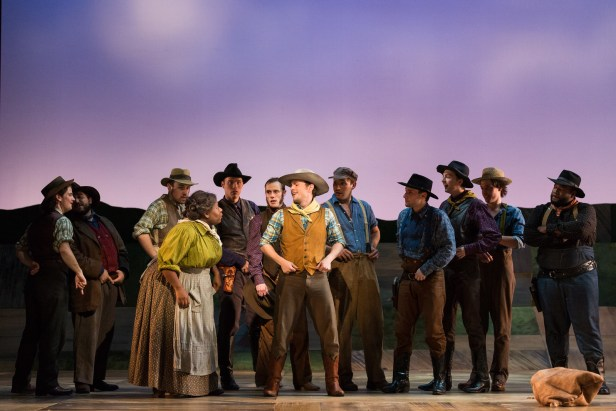 "Judith Skinner as Aunt Eller (left) and Michael Roach as Will Parker (center) with members of the ensemble in The Glimmerglass Festival's 2017 production of Rodgers and Hammerstein's ""Oklahoma!"" Photo Karli Cadel/The Glimmerglass Festival."
