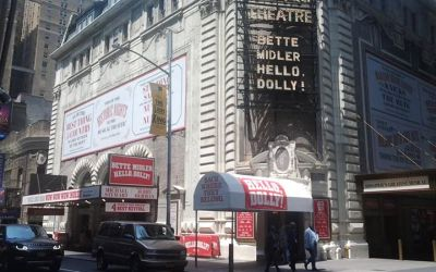 ON THE MARQUEE: WOW, WOW, WOW. They're BACK WHERE THEY BELONG. The Tony Award winning