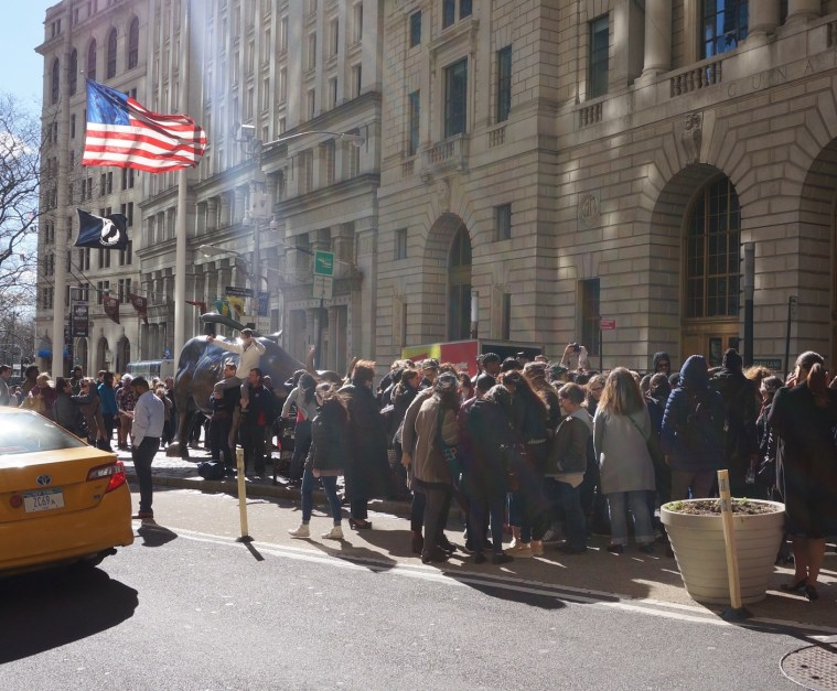 wall street bull womens day girl statue crowd