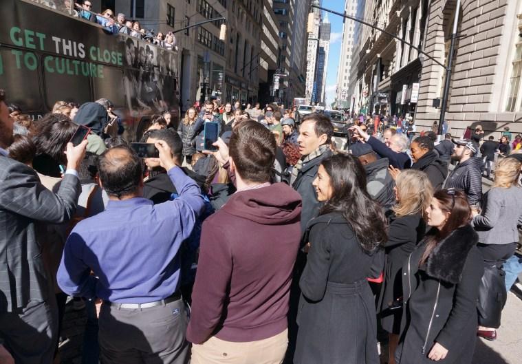 womens day wall street bull crowd