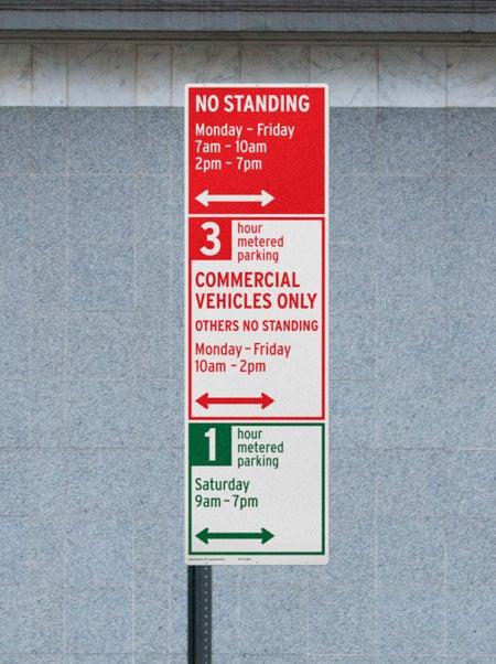Three parking signs on one gotcha pole