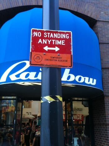 This image is a temporary no standing-anytime parking sign