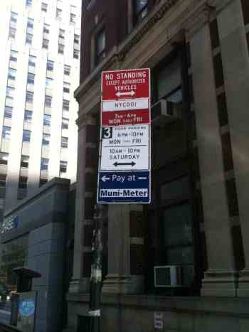 NYC parking signs on a gotcha pole