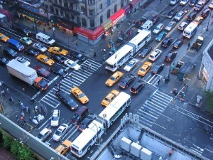 This is an arial view of a four corner NYC intersection with many vehicles blocking the box